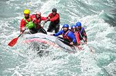 stock photo of raft  - White water Rafting as extreme and fun sport  - JPG