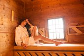 stock photo of sauna woman  - Pretty young woman alone in the sauna - JPG