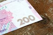 Постер, плакат: Ukrainian Money Background Made Of Two Hundred Hryvnia Notes