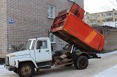 picture of landfill  - The garbage Trucks work on the landfill - JPG