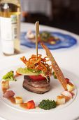 stock photo of chateaubriand  - Elegant tenderloin steak with steamed vegetables topped with deep fried onion tomato and herbs - JPG