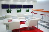 foto of reception-area  - Empty waiting area with white chairs and plasma screens in office  - JPG