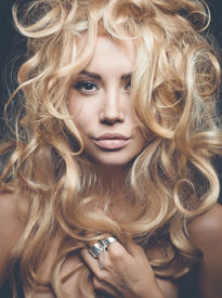 stock photo of perm  - Beautiful woman with magnificent blond hair - JPG