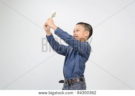 Young Boy With Happy And Smile With American Dollar Bank Note
