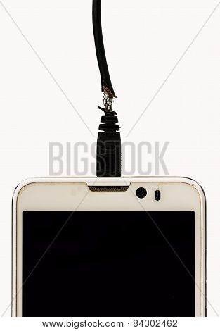 Damaged Charging Of Mobile Phone On White Background.the Concept Of The Dangers Of Defective Electri
