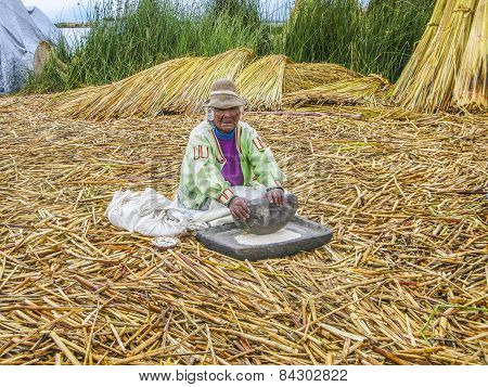 Elderly Lady Prepares Fresh Flour In A Traditional Way