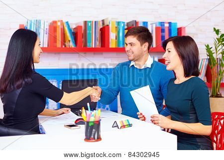 Satisfied Clients, Couple After Successful Business Negotiations In Office