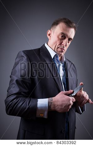 male gangster in a business suit with a knife