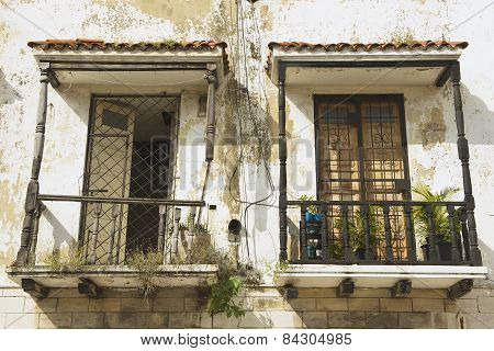 Two vintage balconies in a colonial house in Santo Domingo, Dominican Republic.