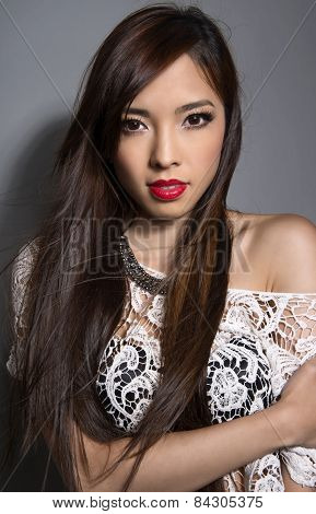 beautiful young asian woman with perfect skin posing in a close up picture