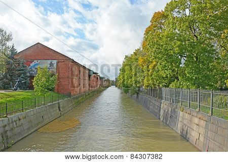 Kronstadt Canal With Blue Sky And Clouds Background