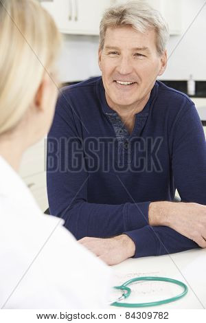 Mature Man Meeting With Female Doctor In Surgery