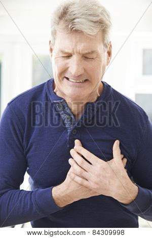 Mature Man Suffering Heart Attack At Home