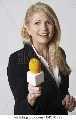Female Journalist With Microphone On White Background