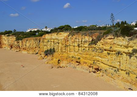 Spectacular cliffs on Senhora Da Rocha Nova Beach in Portugal