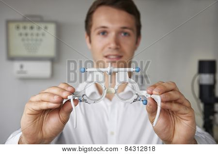 Male Optician Giving Patient Sight Test