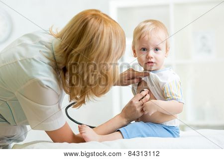 pediatrician examining heartbeat of kid with stethoscope