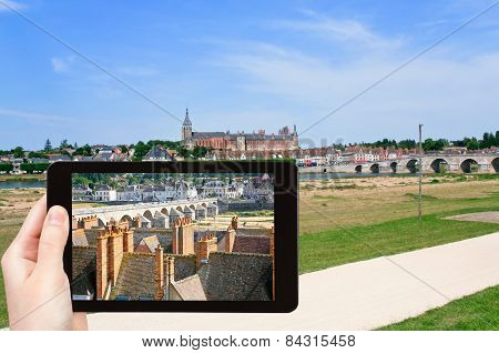 Tourist Taking Photo Of Gien Town, France