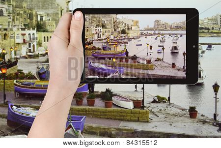 Tourist Taking Photo Of Boats In Old Urban Port