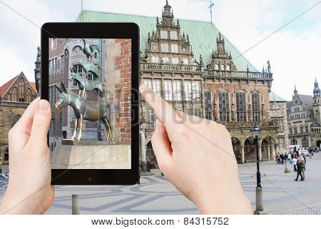 Tourist Taking Photo Of Bremen Town Musicians