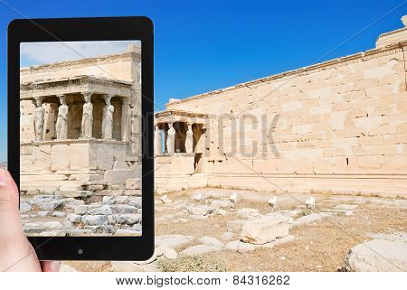 Tourist Taking Photo Of Monument At Acropolis