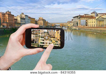 Tourist Taking Photo Ponte Vecchio On Arno River