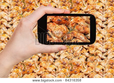 Tourist Taking Photo Of Roasted Chicken Wings