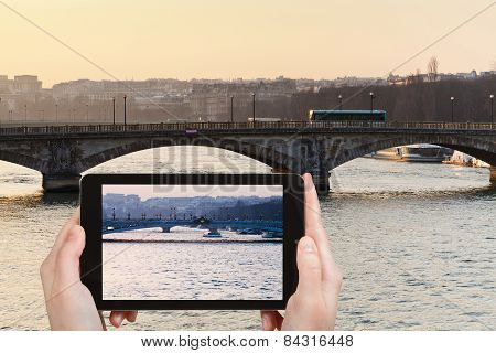 Tourist Taking Photo Of Bridge In Paris On Sunset