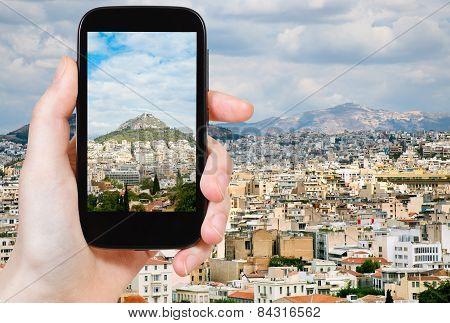 Tourist Taking Photo Of Athens City Skyline