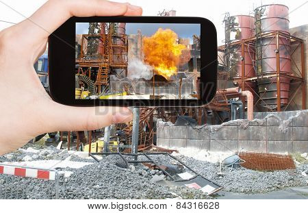 Tourist Taking Photo Of Explosion At Factory
