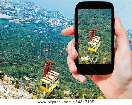 Tourist Taking Photo Of Cableway Miskhor-ai-petri