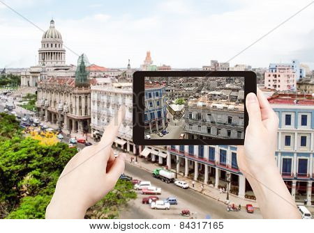 Tourist Taking Photo Of Center Havana City