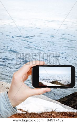 Tourist Taking Photo Of Ice Floes In Bering Sea