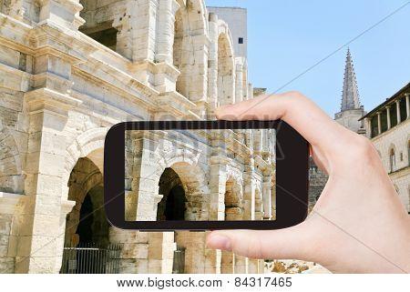 Tourist Taking Photo Of Arles Amphitheatre