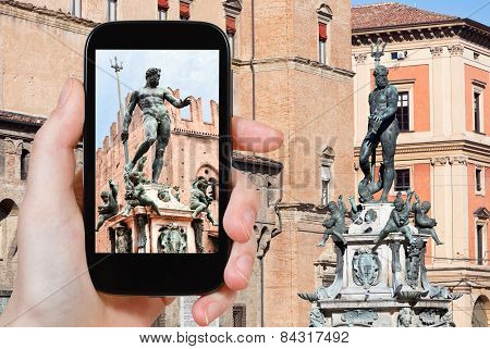 Tourist Taking Photo Of Fountain Of Neptune