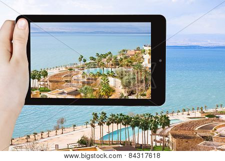 Tourist Taking Photo Of Waterfront On Dead Sea