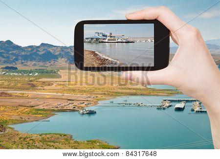 Tourist Taking Photo Of Boulder Beach On Lake Mead