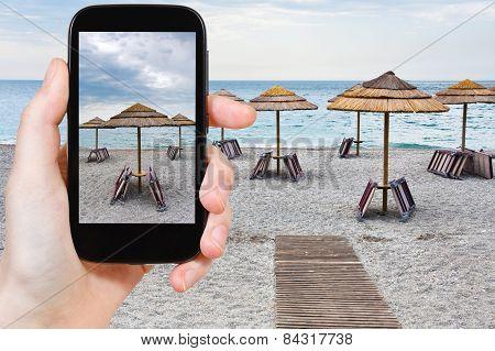 Tourist Taking Photo Of Empty Ionian Sea Beach