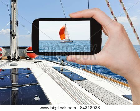 Taking Photo Yacht With Red Sail In Adriatic Sea