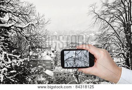 Tourist Taking Photo Of Zurich Skyline In Winter