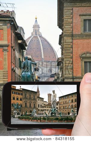 Tourist Taking Photo Of Piazza Della Signoria