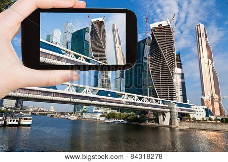 Tourist Taking Photo Of New Moscow City And Bridge