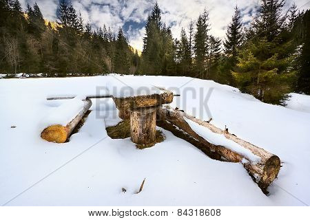 Wooden Table And Benches In A Clearing In The Winter Forest