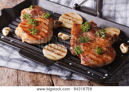 Two Grilled Pork Steak In A Pan Grill Close-up. Horizontal