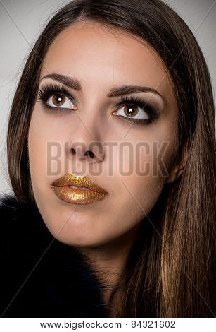 Pretty Long Hair Woman With Gold Lips Looking Up