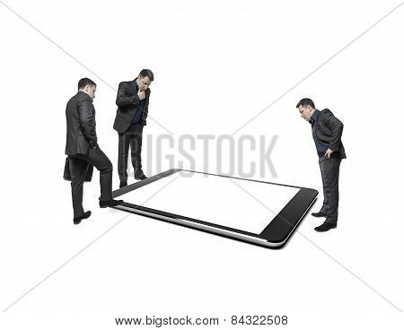 Businessmen Take Counsel, Looking At Huge Display Of Tablet Computer.
