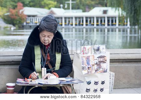 Japanese Street Artist Painting In Central Park New York City
