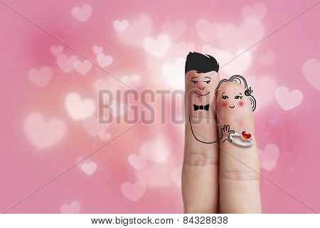 Conceptual Finger Art Of A Happy Couple. Man Is Giving A Ring. Stock Image