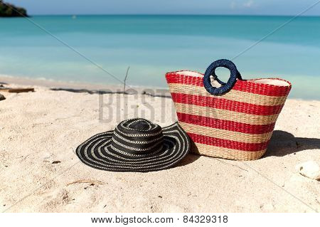 Beach Bag And Hat On The Beach