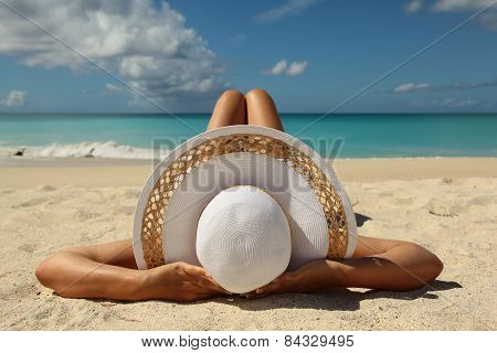 Tanned Young Girl Leying On The Beach